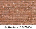 An old red brick wall background photograph. - stock photo