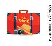 tourist suitcase  camera and...