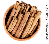 cinnamon sticks in wooden bowl. ... | Shutterstock . vector #536837515