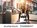 young woman lifting weights in... | Shutterstock . vector #536888047