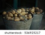 Potatoes In Buckets.