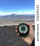 Small photo of MEJIA, ECUADOR - AUGUST 6, 2016: An altimeter in my hand in Cotopaxi National Park in Ecuador close to a volcano Cotopaxi