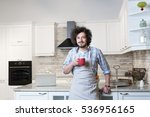 good looking man in an apron in ... | Shutterstock . vector #536956165