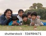happy latin family in the park | Shutterstock . vector #536984671