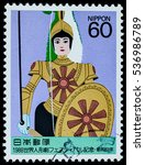 """Small photo of BANGKOK, THAILAND - OCTOBER 08, 2016: A postage stamp printed in Japan shows war girl doll marionette on rope control, series """"World puppetry festival """", circa 1988."""