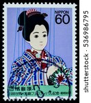 """Small photo of BANGKOK, THAILAND - OCTOBER 08, 2016: A postage stamp printed in Japan shows asian girl doll marionette on rope control, series """"World puppetry festival """", circa 1988."""