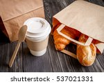 cup coffee and croissant in... | Shutterstock . vector #537021331
