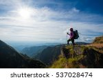 young woman hiking stand...   Shutterstock . vector #537028474