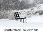 bench covered in snow on a... | Shutterstock . vector #537044581