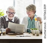 senior adult reading newspaper... | Shutterstock . vector #537061309