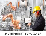 engineer looking at laptop for... | Shutterstock . vector #537061417