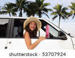 car rental: happy woman in her new car near the beach - stock photo