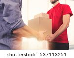 man accepting a delivery of... | Shutterstock . vector #537113251