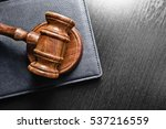 Small photo of Judge's Gavel over black background
