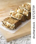 Small photo of Carrot cake slices on wood board with lace table, coth.