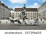 Small photo of VIENNA, AUSTRIA - July 12: horse carriage accompany tourists visiting the city of Vienna on July 12, 2016 in Vienna, Austria.
