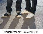 two men legs and feet in jeans... | Shutterstock . vector #537341041
