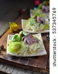 Small photo of Christmas salad with octopus in a la carte dishes from the dough New Year