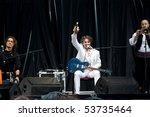 "LVIV - MAY 22: Singer Goran Bregovic drinks beer at stage on festival ""Stare Misto"" (""Old city""), May 22, 2010 in Lviv, Ukraine - stock photo"