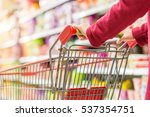 lady pushing a shopping cart in ... | Shutterstock . vector #537354751
