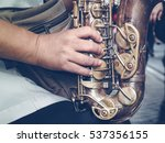 Saxophone In The Hands On Urba...