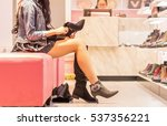 legs of lady trying on several... | Shutterstock . vector #537356221