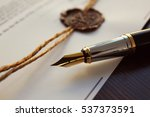 fountain pen and old notarial... | Shutterstock . vector #537373591