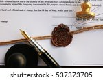 Small photo of Old notarial wax seal and stamp on document, closeup