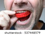 man placing a red bite plate in ... | Shutterstock . vector #537448579