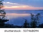 Calm water and silhouetted trees on Hecla Island Provincial Park, Manitoba