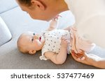 smiling cute baby girl playing...   Shutterstock . vector #537477469