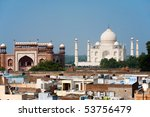The Taj Mahal and the taj ganj neighborhood's rooftops are seen from a distance. - stock photo