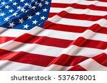 closeup of ruffled american flag | Shutterstock . vector #537678001