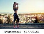 female jogger drinking water... | Shutterstock . vector #537703651