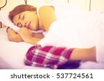 innocent girl grabbing pillow... | Shutterstock . vector #537724561