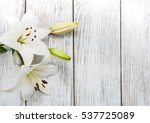White  Lilies On A Old Wooden...