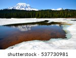 Mount Rainier Reflects Its Sno...