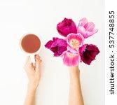 Flowers And Tea Mug In Woman...
