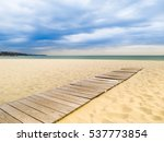 Wooden Boardwalk To The Sea On...