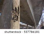 Damaged bridge support close - up transportatin concrete - stock photo