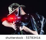 soldier shooting with laser gun.