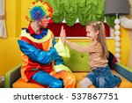 little girl and  clown play... | Shutterstock . vector #537867751