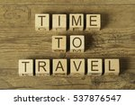 Time To Travel Text On Wooden...