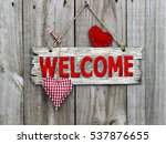 red welcome sign hanging by... | Shutterstock . vector #537876655