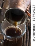 fresh coffee from cezve pouring ... | Shutterstock . vector #537914137