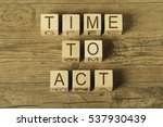 time to act ext on wooden cubes ... | Shutterstock . vector #537930439