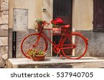 Red Bicycle With Flower Pots...