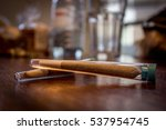 rolled and wrapped joint in... | Shutterstock . vector #537954745