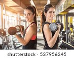 girls lifting weights in gym. | Shutterstock . vector #537956245
