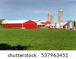 Farm With Red Barns  Silos And...